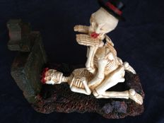 Fantasy art; Skeleton couple making love on tombstone - 1990