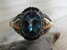 Silver vintage ring with gold and natural topaz.