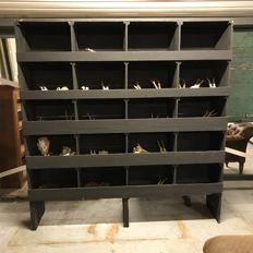 French industrial black compartment cabinet, 20 compartments, made in France around 1930.