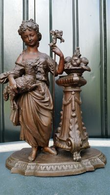 Richly ornamented sculpture of a shepherdess with a lamb in a bronzed metal alloy - France - end of 19th century