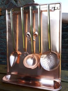Old kitchen utensil display made of red copper made in France