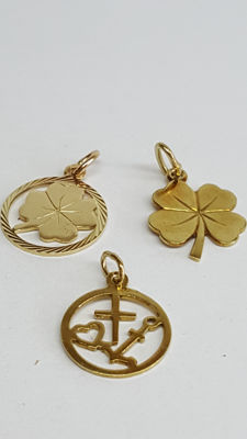 14 kt yellow gold set of pendants/charms, 3 pieces, approx. 1.5 cm