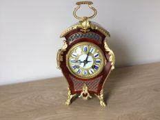 France, around the 19th century, a console clock in a case with glued-on tortoise, with gold plated fittings.