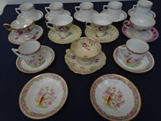 Lot with 12 cups and saucers with nice depictions