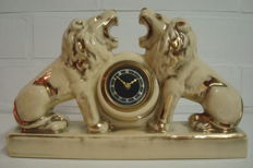 Nice Art Deco clock flanked by two lions