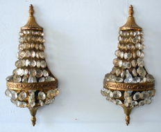 Set of wall lamps with crystal beads and gold coloured motifs.