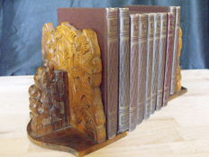 Various bookends and a series of books