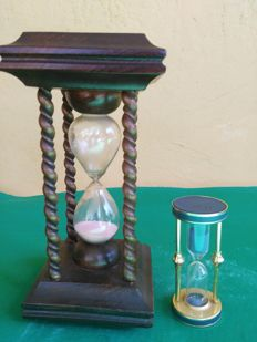 Pair of old table hourglasses, one in wood and glass, completely hand machined and hand finished.