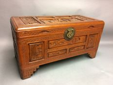 Beautiful wooden chest with Oriental hand carved decorations