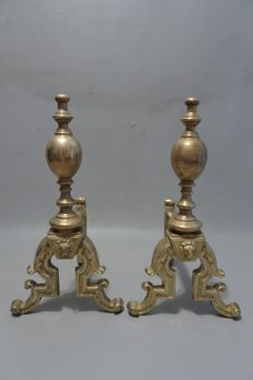 Pair of yellow copper andirons with lion heads, mid 20th century