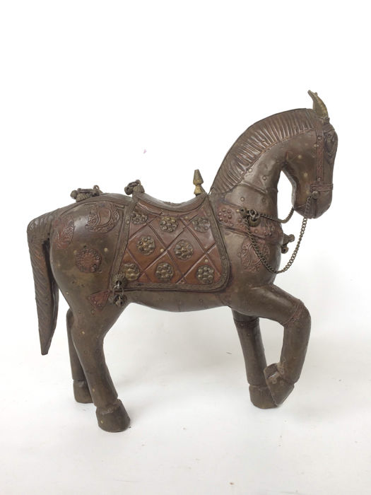 Antique horse decorated with latten copper
