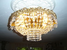 Nice large heavy antique Swarovski crystal ceiling lamp with a gold plated decorated bronze ring, France, 1960s