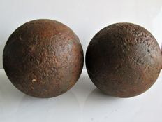 Two solid iron cannonballs from the Eighty Years' War from an excavation site near Geertruidenberg