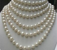 Long necklace of individually knotted fresh water cultivated pearls with a white gold clasp, marked 14 k, 250 cm