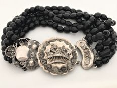 Hand-made, five-strand jet bracelet with a sizeable silver decorative clasp.