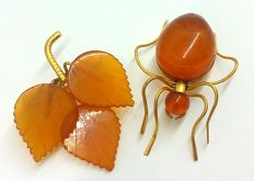 Two vintage gold plated brooches of Baltic Amber, a spider and a leaf brooch