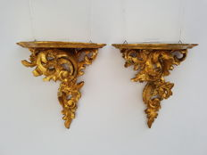 Two richly carved gold leaf gilded wooden consoles, in Rococo style - Italy - late 19th century