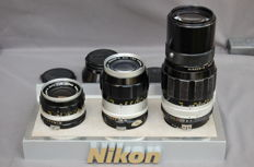 Nikon lenses 35 mm--135mmm--200 mm in rare store display