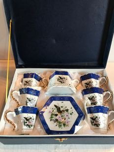 Coffee service, 13 pieces, in fine porcelain decorated with violets