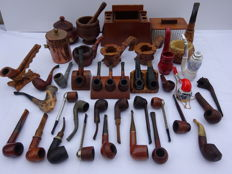 Pipes, tobacco jars, ashtrays and pipe rack