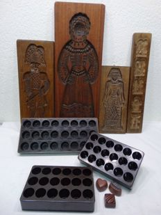 Three Bakelite bonbon chocolate moulds, brand Marco - four hand-carved gingerbread boards