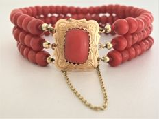 Antique three-row red coral cheeses bracelet with 14 kt gold engraved clasp