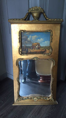 A large gold-coloured baroque mirror with an image of a horse-drawn carriage and farmers, ca. 1990