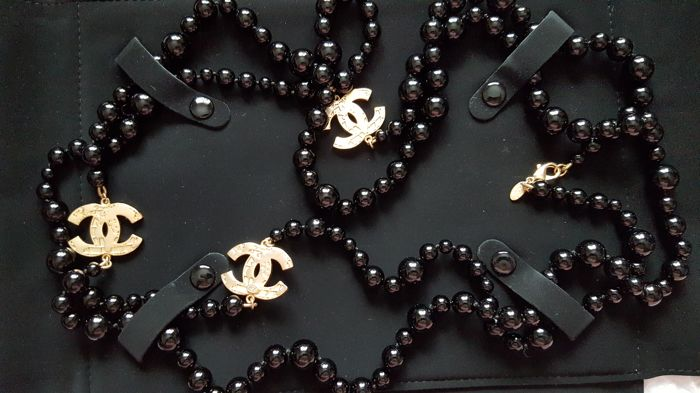 Genuine CHANEL extra long black pearls necklace