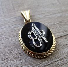 Spanish Gold 'A' pendant with diamond accents