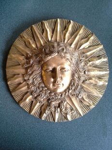 Beautiful wall decoration, gold-coloured sun angel