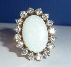 A solid ring made from 14 kt / 585 gold with a 3 ct heavy Australian full opal + 1.1 ct brilliant-cut diamonds
