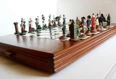 Chess with pieces handmade of tin. Wooden furniture with enamelled ceramic board.