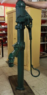 Heavy and large old pump of a village square, ca. 1950, Germany