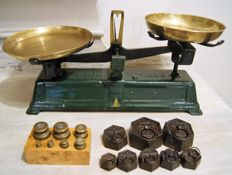 Weight and a set of brass weights and french hexagonal weights.