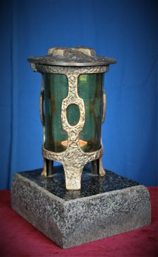 Bronze lantern on a stone base