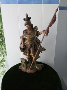 Saint Florian, patron saint of firefighters, made of carved wood and painted in colour - second half of the 18th century