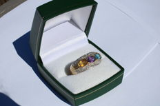 14kt ring with 3 different colour topaz and 0,54ct diamond approx - size 7
