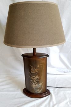 Very distinct bronze standard lamp with engraving