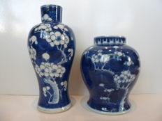 Two porcelain vases with prunus decoration – China – 19th century