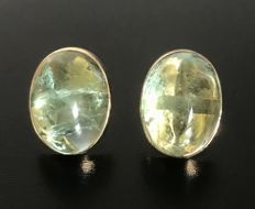 Earrings in 18 kt rose gold decorated with neon green tourmaline cabochons, each 20 ct