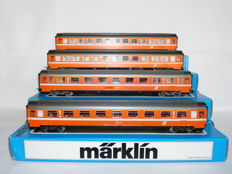 Märklin H0 - 4149/4167 - four passenger carriages in the orange livery of the ÖBB