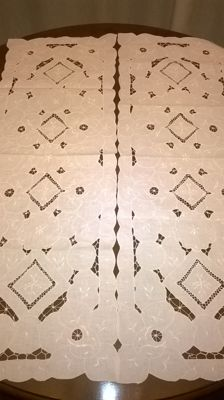 Two handmade table covers in intagno and padded satin stitch