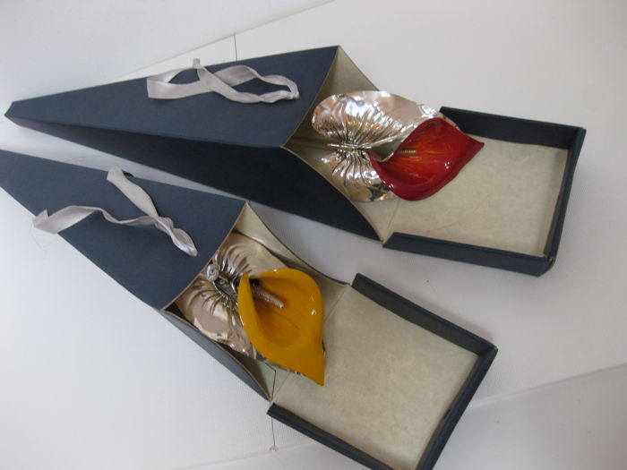 """Two """"Calla"""" flowers, silver 925 and hot processed enamel, with silver stem and leaves, in cardboard box."""