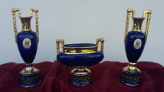 Triptych in cobalt blue porcelain with a ceramic cameo applied in the centre - Italian school
