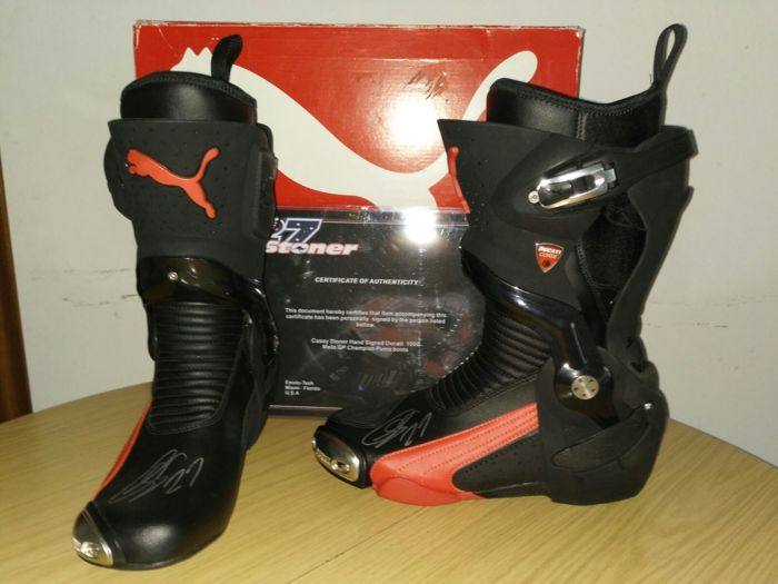 Moto GP - Champion Puma - boots signed by Casey Stoner