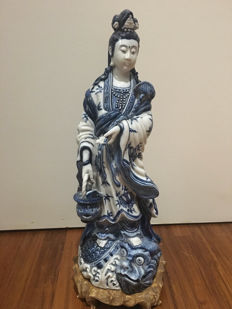 A blue and white porcelain statue representing Guanyin - China - late 20th century