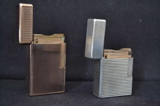 Dupont pair of lighters - Silver plated / Gold plated- France - 20th century