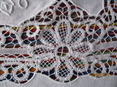 Lush hand embroidered and bobbin lace tablecloth with 12 napkins.