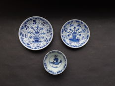 Two floral saucers + L. Leis cup – China – 18th century (Kangxi period)