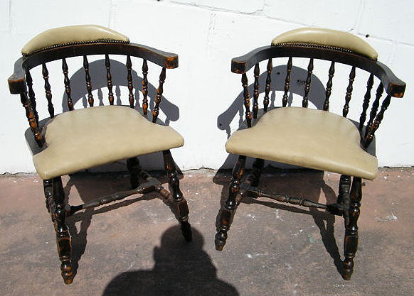 Set of two chairs made of solid wood and upholstered in leather, mid 20th century